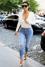 romper,kim,kardashians,jumpsuit,bodysuit,kim kardashian,curvy,girl,ootd,jeans,denim,shirt,frayed,frayed jeans,blue jeans,celebrity style,celebrity,cropped jeans,white top,top,v neck,long sleeves,sunglasses,gold shoes,high heels