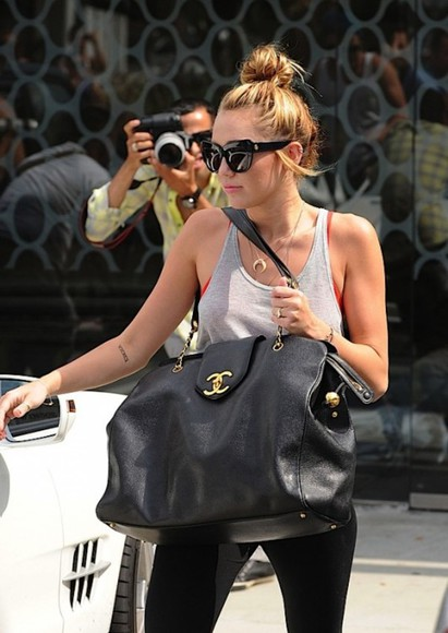 celebrity gold bag chanel miley cyrus black brand rich luxury