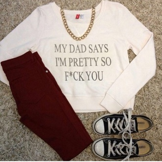 top white top gold necklace red pants