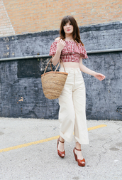 sea of shoes,blogger,top,pants,shoes,bag,red top,red off shoulder top,crop tops,red crop top,ruffle,ruffled top,wide-leg pants,white pants,palazzo pants,culottes,high waisted pants,basket bag,straw bag,sandals,brown sandals,ankle strap heels,wedges,wedge sandals