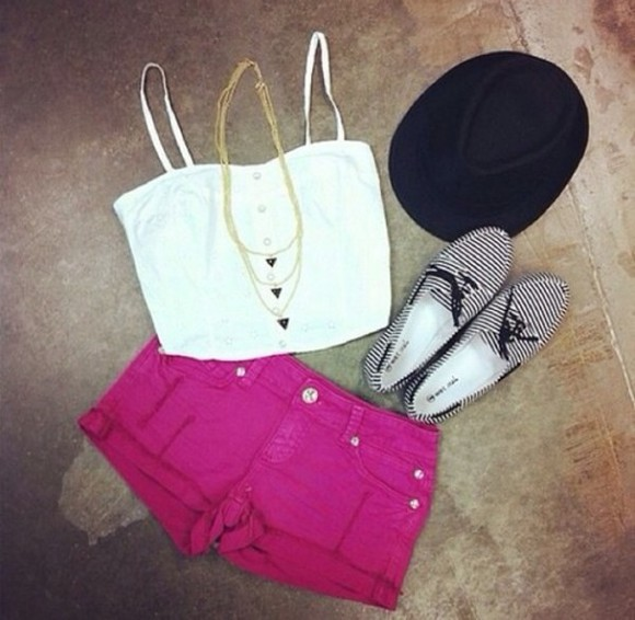black hat shorts pink shorts white crop top black and white shoes