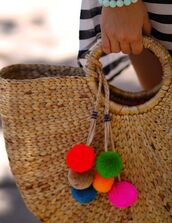 bag,pompom bag,pompom basket bag,basket bag,beige basket bag,pom poms,beach bag,raffia bag