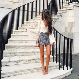 blouse bell sleeve top tumblr white blouse bell sleeves v neck shorts printed shorts sandals sandal heels high heel sandals nude sandals bag nude bag summer outfits long sleeves shoulder bag