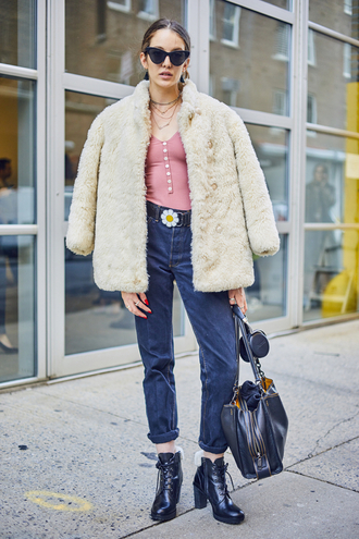 jacket nyfw 2017 fashion week 2017 fashion week streetstyle white jacket white fur jacket fur jacket faux fur jacket top pink top sunglasses cat eye bag black bag denim jeans blue jeans cuffed jeans boots black boots high heels boots lace up boots 00s style