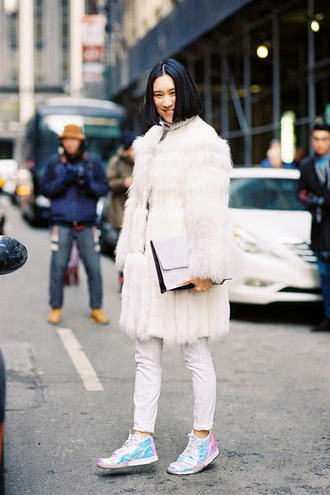 blogger jeans fur coat holographic shoes clutch fall outfits shoes big fur coat eva chen white coat pants white pants bag white bag streetstyle irredescent sneakers white fur coat winter outfits winter look white winter outfit white oversized coat faux fur coat white jeans
