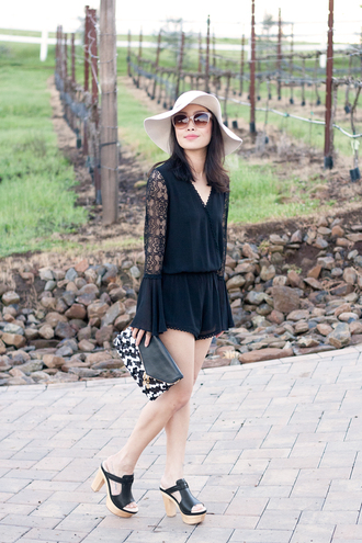 it's not her it's me blogger romper black heels pouch floppy hat shoes bag hat sunglasses jewels printed pouch white hat black romper lace romper sandals black sandals mules