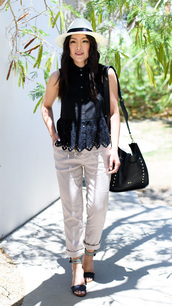 the fancy pants report,blogger,top,hat,bag,shoes,eyelet top,eyelet detail,peplum top,black top,sleeveless shirt,black shirt,black bag,capri pants,capris,sandals,spring outfits