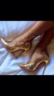 shoes,heels,straps,gold,sexy shoes,gold jewelry,louboutin,heel,pointy,kim,gold shoes,fashion,style,fairy tale,lace up,shiny,gold heels,high heels,party shoes,strappy heels,christian louboutin heels
