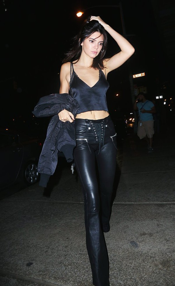 pants celebrity style celebrity black leather pants leather pants black pants lace up pants flare pants black crop top crop tops black top jacket black jacket kendall jenner model model off-duty