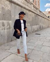 jeans,light blue jeans,high heel sandals,clutch,white t-shirt,black blazer,fisherman cap,earrings