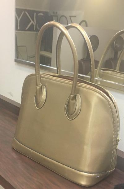 bag patent bowler gold satchel