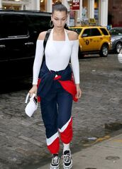 top,sneakers,sweatshirt,sweatpants,streetstyle,model off-duty,off the shoulder,off the shoulder top,white top,bella hadid,pants