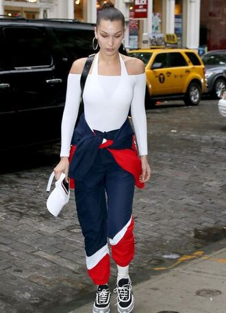 top sneakers sweatshirt sweatpants streetstyle model off-duty off the shoulder off the shoulder top white top bella hadid pants