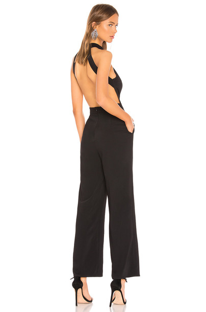 About Us Lauren Halter Jumpsuit in black