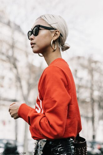 sweater accessory tumblr red sweater blonde hair hair hairstyles sunglasses earrings hoop earrings jewelry paris fashion week 2017 fashion week streetstyle fashion week 2017