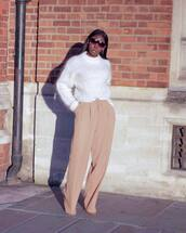 sweater,knitted sweater,white sneakers,wool sweater,high waisted pants,wide-leg pants,sunglasses,earrings