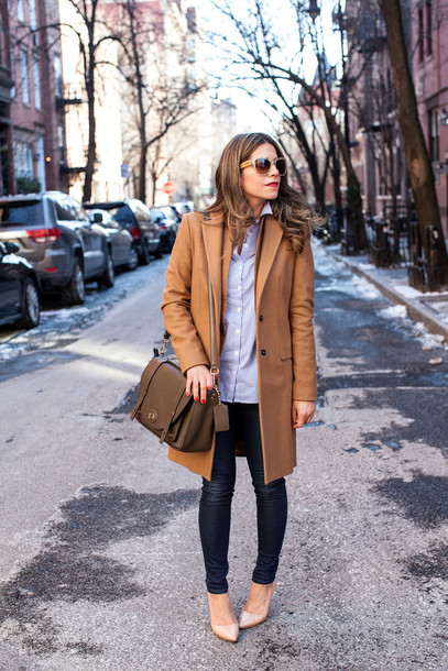 the corporate catwalk blogger leggings camel coat blue shirt office outfits satchel bag coat brown coat white shirt skinny jeans nude heels brown bag