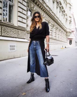 top long top tumblr shirt dress black top asymmetrical top asymmetrical denim jeans blue jeans cropped jeans wide-leg pants boots black boots ankle boots sunglasses