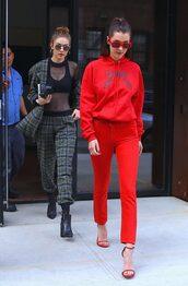 pants,red,sandals,sweatshirt,bella hadid,gigi hadid,hadid sisters,model off-duty,sunglasses,hoodie