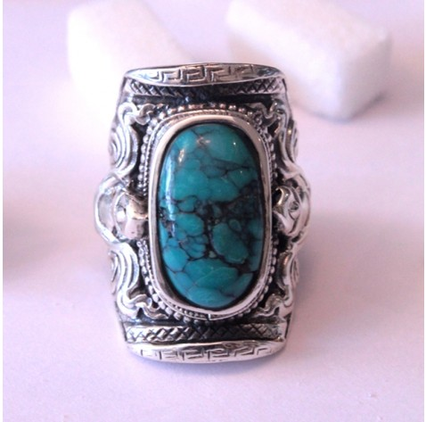 Turquoised : Statement ring set with a beautiful Turquoise and embellished with Repousse' and Chasin | Ananasa