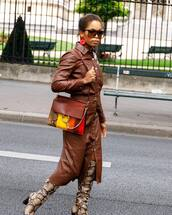 dress,leather dress,long sleeve dress,button up,knee high boots,snake print,shoulder bag,sunglasses,earrings