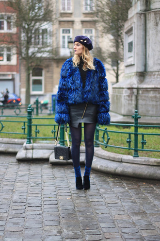 from brussels with love blogger coat skirt tights shoes bag winter outfits beret faux fur coat chanel bag leather skirt