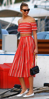 top,red off shoulder top,striped off shoulder top,crop tops,red top,off the shoulder,off the shoulder top,midi skirt,striped skirt,red skirt,high waisted skirt,black bag,bag,ballet flats,flats,white flats,karlie kloss,model,model off-duty,sunglasses,cat eye,summer outfits,summer top
