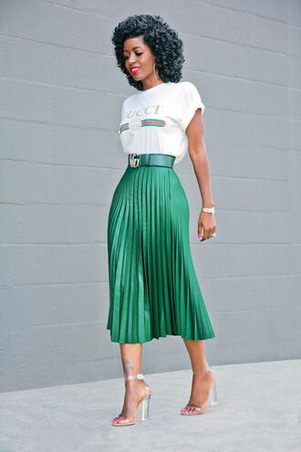 t-shirt gucci t-shirt gucci white t-shirt green skirt midi skirt skirt pleated skirt sandals transparent sandals red lipstick green belt leather belt emerald satin emerald satin pleated tea skirt tea outfit silvery chunky-heeled sandals tea skirt emerald skirt outfit gucci belt