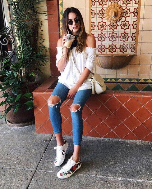 shoes gucci ace sneakers gucci gucci shoes floral sneakers sneakers white sneakers low top sneakers denim jeans blue jeans ripped jeans white top top off the shoulder off the shoulder top bag white bag tassel sunglasses round sunglasses cropped jeans