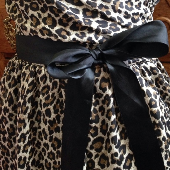 Delia's  - Cheetah dress with black bow sash from Shannon's closet on Poshmark