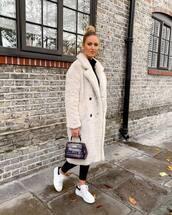 coat,faux fur,white sneakers,handbag,black turtleneck top,black leggings