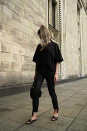 pants,leather pants,black pants,slide shoes,black blouse,bag