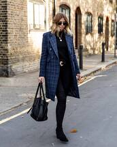 coat,long coat,checkered,black sweater,knitwear,pants,skinny pants,handbag,suede boots,black boots,belt,sunglasses,chain necklace