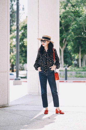 hallie daily blogger blouse jeans bag hat shoes sunglasses straw hat sun hat shirt black shirt blue jeans cropped jeans mid heel pumps pumps red pumps red shoes shoulder bag chain bag red bag black sunglasses spring outfits long sleeves block heels red loafers