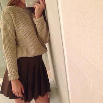 top green sweater black skirt