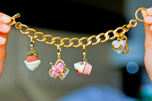 jewels,gold bracelet,strawberry,crown,cupcake,love heart,jewlry,fashion,hashtags,cake,bracelets,charm bracelet