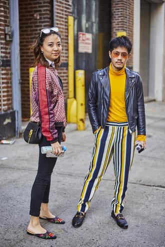 jacket nyfw 2017 fashion week 2017 fashion week streetstyle denim jeans blue jeans shoes slide shoes printed jacket satin bomber bomber jacket bag black bag menswear mens pants mens jacket mens top mens shoes