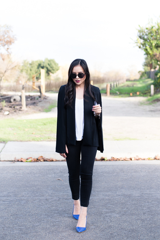 the fancy pants report blogger sunglasses cropped pants classy cape