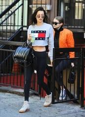 shoes,bella hadid,gigi hadid,grey sweater,black leggings,black bag,white sneakers,orange,bomber jacket