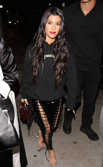 pants lace up kourtney kardashian hoodie yeezy kardashians keeping up with the kardashians celebrity celebrity style celebstyle for less lace up pants black pants sexy sexy outfit sexy pants cute girly date outfit clubwear