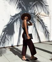 shoes,slide shoes,black shoes,jumper,cropped jumpsuit,leather clutch,sleeveless,backless,hat,earrings