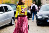 sweater,fashion week street style,fashion week 2016,fashion week,milan fashion week 2016,printed sweater,yellow sweater,yellow,pink skirt,streetstyle,fall outfits,midi skirt,yellow jumper,fall skirt,cats