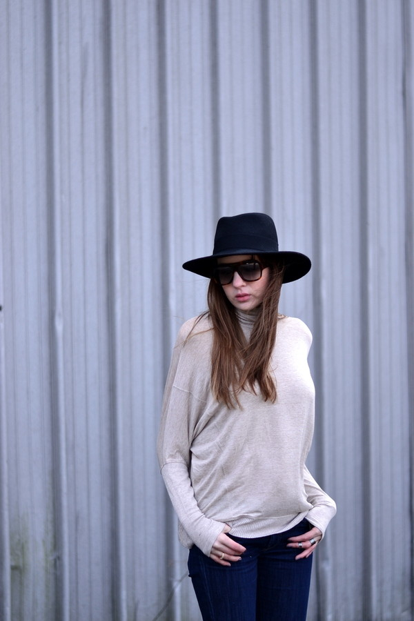 shot from the street hat shoes jeans sweater sunglasses