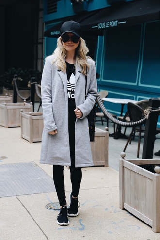 somewherelately blogger t-shirt leggings sweater jacket shoes sunglasses cap grey coat winter outfits adidas sneakers