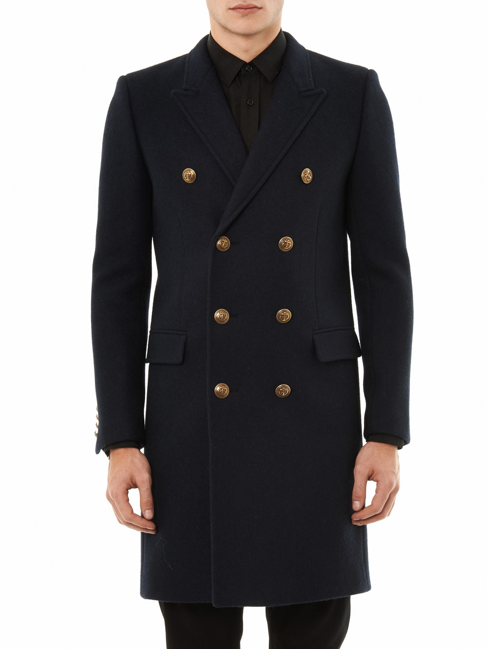Double-breasted overcoats- classic, masculine, and baller Back on top of the trends list, a Double-breasted overcoat is what you need when you wanted to exude a stylish yet classic look.