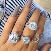 jewels,hand jewelry,jewelry,gemstone ring,ring,engagement ring,diamonds,diamond ring,wedding ring,bling,silver ring