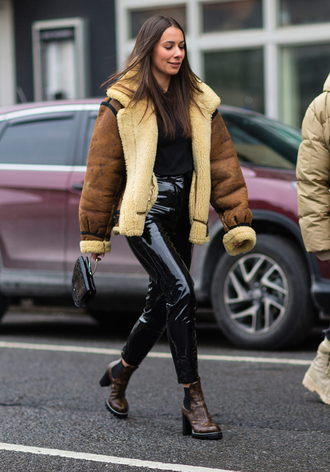pants nyfw 2017 fashion week 2017 fashion week streetstyle black pants leather pants black leather pants black vinyl pants vinyl sweater black sweater jacket brown jacket brown shearling jacket shearling jacket shearling boots brown boots ankle boots high heels boots mini bag