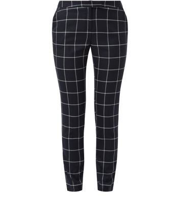 Navy grid print trousers