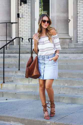 twenties girl style blogger skirt shoes sunglasses jewels brown bag denim skirt button up off the shoulder fringed bag lace up heels lace up flats tortoise shell tortoise shell sunglasses brown sunglasses off the shoulder top mini skirt blue skirt sandals flat sandals gladiators