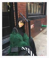 sunglasses,coat,yellow sunglasses,top,black top,pants,black pants,side stripe pants,black sweatpants,sweatpants,bag,black bag,green coat,kayture,kristina bazan